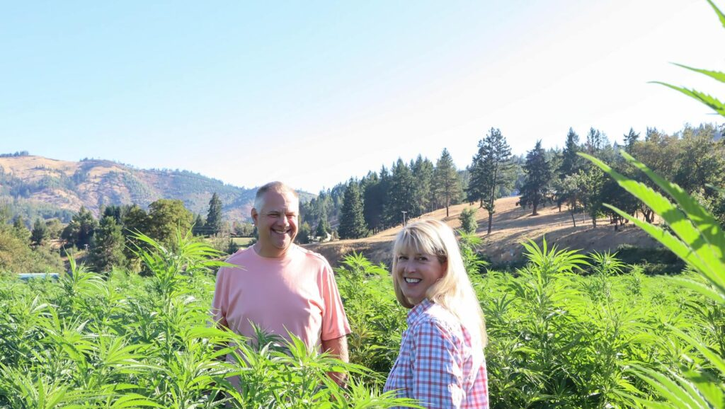 Clint and Danette Thompson in the God's Glory Hemp Fields